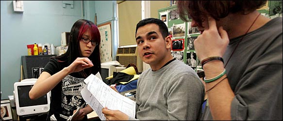 Kathleen Ching, left, winner of a top prize in the 2005 Scholastic Art and Writing Awards, with her teacher, Carlos Molina, a past winner.